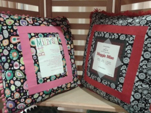 Custom pillows with invitations scanned on in fabric. Mostly $55.