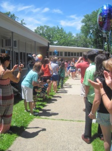 Parents lining the walkway prepared for the outgoing 5th graders to leave elementary school for the last time