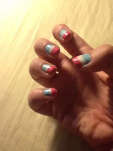 We didn't have time to go for manicures, so I painted on the design Dori came up with. It looked a bit like a Pepsi log.