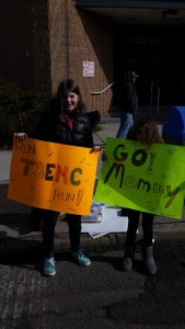 The girls get their signs ready.