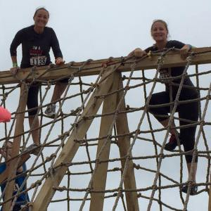 Hiking up the net. Photo courtesy of Rugged Maniac.