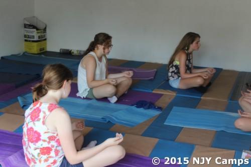 Dori doing yoga.