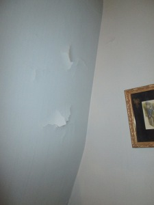 The ceiling peeled too.